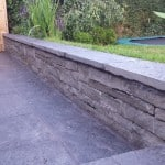 Shown here our sawn Liscannor patio paving and building stone in a garden setting