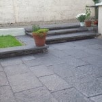 Shown here our sawn Liscannor Stone in a garden setting. In this picture a sealer has been applied to the stone
