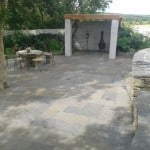 Our Liscannor Stone Patio Paving in a garden setting. Also seen here our wall capping