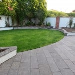 Shown here our sawn liscannor stone patio paving and wall capping in a garden setting