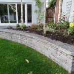 Our Flagstone Wall Capping seen here with our Guillotined Building Stone in a garden setting