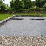 Our Sawn Liscannor Flagstone, Wall Capping and Pier Caps in a garden setting.