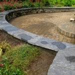 Our flagstone capping on a raised garden bed