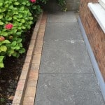 Our Flagstone creates a beautiful natural footpath area around house as seen here