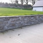 Guillotned stone and stone wall capping in garden setting